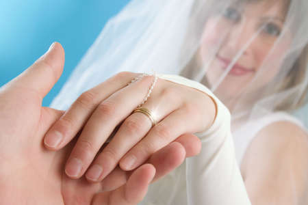 The bride stretches a hand with a ring