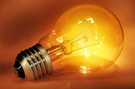 Close-up of a glowing light bulb. Symbol of idea. photo