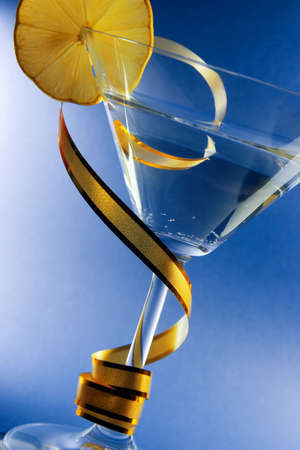 Martini with a lemon on blue background photo