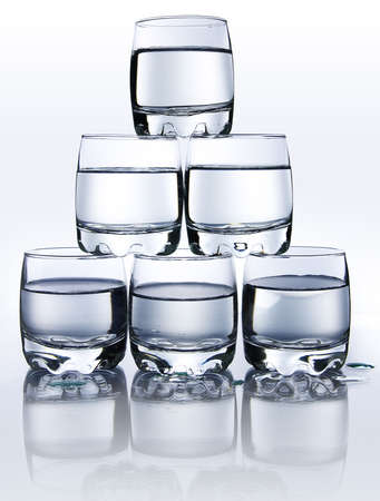 Pyramid from glasses with vodka photo