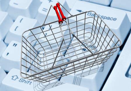 Shopping basket on computer keyboard photo
