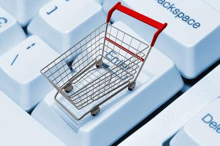 Shopping cart on computer keyboard