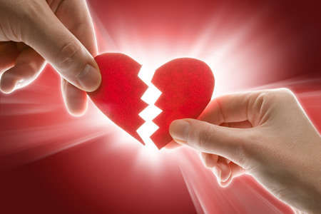 quarrel: Female and mans hands with broken heart