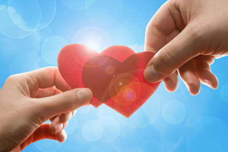 Female and man's hands with red hearts Stock Photo - 5990720