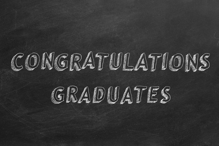 CONGRATULATIONS GRADUATE writing on chalkboard