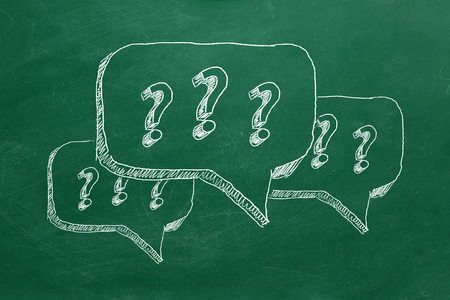 Hand drawing question marks on green chalkboard Stock Photo