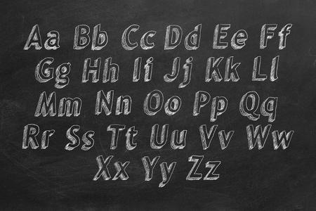 Hand drawing alphabet on blackboard