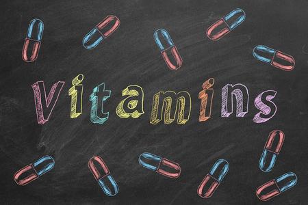 Vitamins word on blackboard