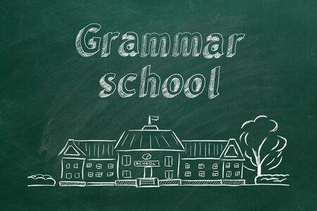 School building  and lettering Grammar school on blackboard. Hand drawn sketch.