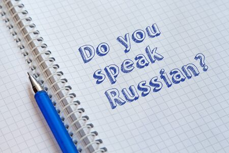 Do you speak Russian? Text handwritten on sheet of notebook