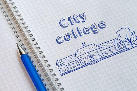 Text City college handwritten on sheet of notebook