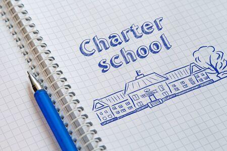 Text Charter school handwritten on sheet of notebook 写真素材