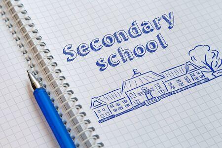 Text Secondary school handwritten on sheet of notebook 版權商用圖片