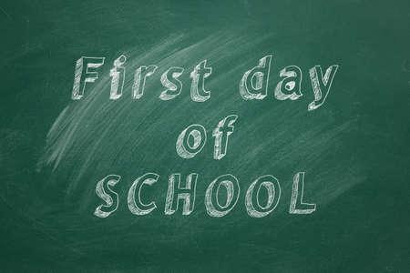 Lettering First Day of School on green chalkboard Stock fotó