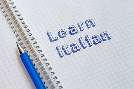 Learn Italian. Text handwritten on sheet of notebook
