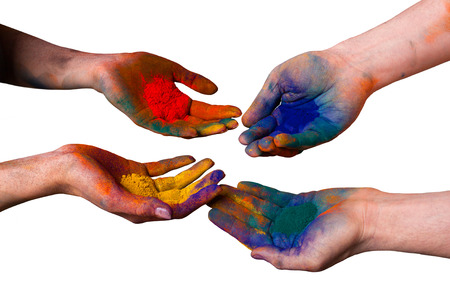 Colorful painted hands, holding holi isolated on white photo