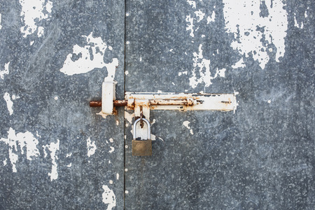 Closeup metal door with lock in grungy rusted style and good texture. photo