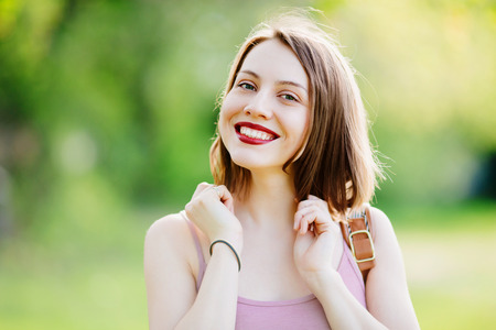 gleeful: Portrait of young happy smiling girl Stock Photo