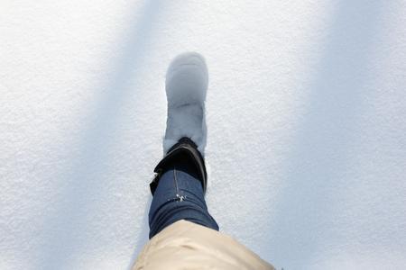 deep powder snow: A step in a deep snow