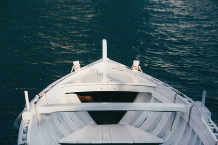 bow of boat: View from the bow of a wooden boat. Stock Photo
