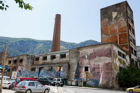 outworn: Abandoned factory building with graffiti art. Kotor it is a very popular travel destination of Europe Editorial