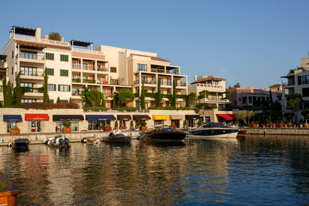 reverberation: Tivat, Montenegro  - August 30, 2015: Hotels, shops and yachts in a luxury yacht marina in Porto Montenegro, a popular touristic attraction in Adriatic sea