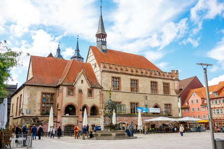 Goettingen, Germany - September 14, 2015: City Hall Square in Goettingen with the Gaenseliesel fountain and pedestrian zone of an old town center. Main market square. Editorial