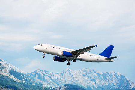 aircraft take off: Aircraft take off. Mountains view. Passenger airplane