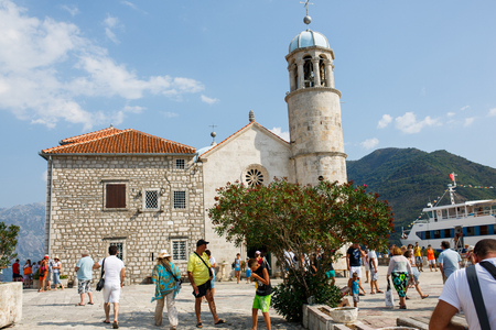 Perast, Montenegro - August 12, 2015: View of the island  Our Lady of the Rocks with St. George island on the background