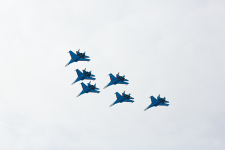 aerobatics: Omsk Russia - 19 March 2016: Aerobatics performed by aviation group of aerobatics Military-air forces Russian Knights on planes Su-27
