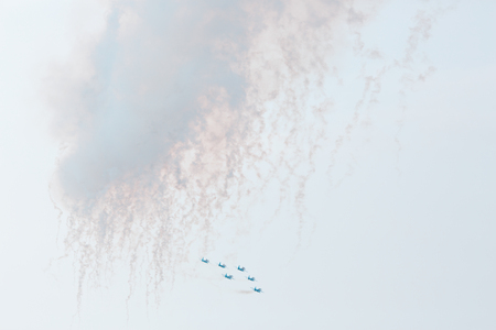 aerobatic: Airplanes on airshow. Aerobatic team performs flight at air show with smoke Stock Photo
