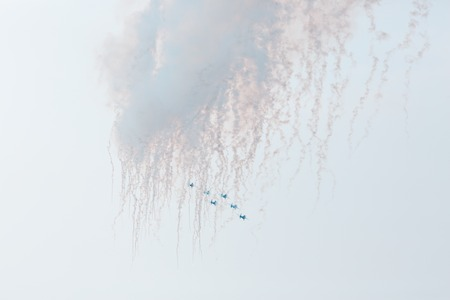 airshow: Airplanes on airshow. Aerobatic team performs flight at air show with smoke Stock Photo