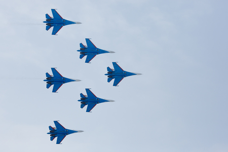 air demonstration: Omsk Russia - 19 March 2016: Performance of Russian Knights at the air show