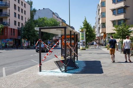 Berlin, Germany - June 23, 2016: Vandalised bus stop in Berlin Kreuzberg, Germany Editorial