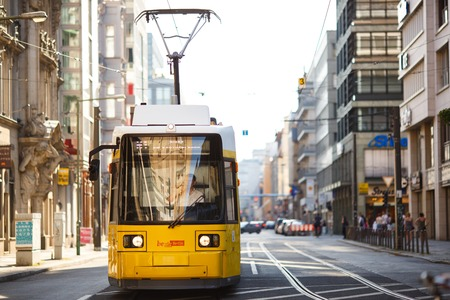 Berlin, Germany - June  26, 2016: Yellow tram in Berlin Mitte, Germany. Tramway public transport