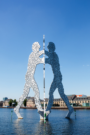 Berlin, Germany - June 23, 2016: Molecule Man sculpture on the Spree river