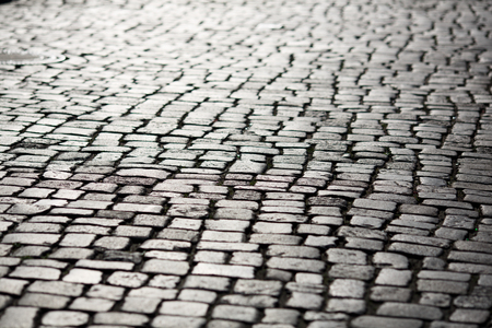 Stone pavement texture in perspective, shallow depth of field