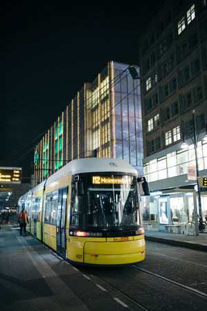 Berlin, Germany - December 7, 2016. Yellow tram in the evening hour at Mitte Central district of Berlin. Alexanderplatz station. Editorial