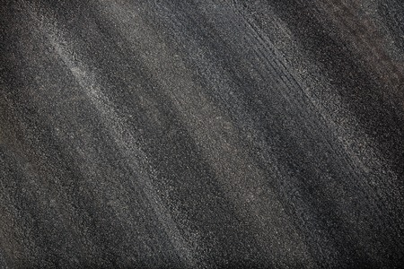 New dark grainy asphalt road texture or background Banco de Imagens