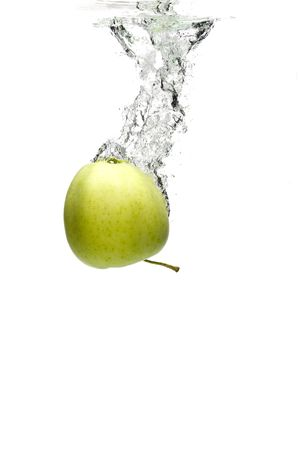 green apple in water on a white background photo