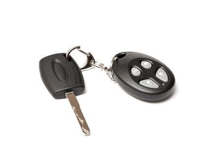 key in the lock: car key on white background