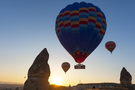 Balloons in the sky over Cappadocia at sunrise, turkey photo