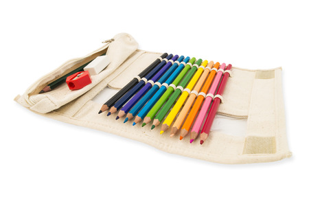 Colour pencils in pocket bag fabric on white isolated background with clipping path.