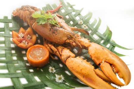 lobster tail: Baked lobster with cheese and spicy sauce served on banana leaves.
