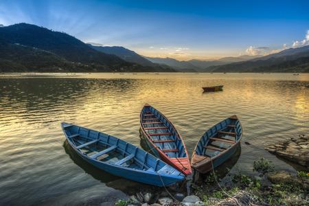 Boats on fewa lake in pokhara nepal photo