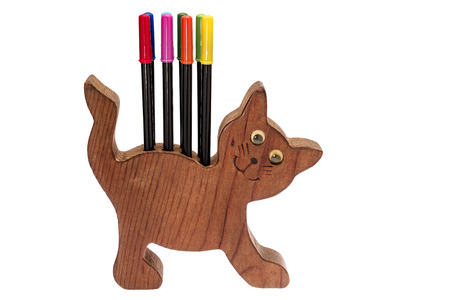 Colorful pens and cat pen holder on white