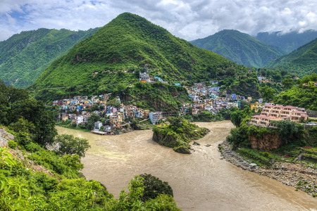 devprayag: The Ganges begins at the confluence of the Bhagirathi and Alaknanda rivers at Devprayag.  Mountain river confluence Stock Photo