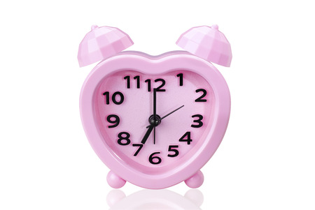 pink alarm clock on white isolated background with clipping path.