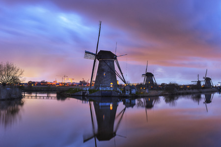Windmills at twilight after sunset in the famous kinderdijk, Netherlands