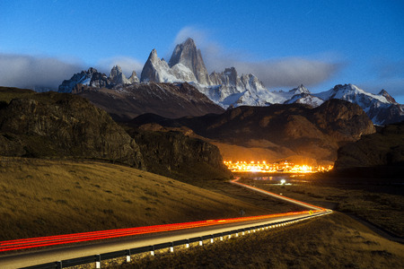 fitz roy: Monte Fitz Roy in los glaciares national park with car light trail and the road to El Chalten, Patagonia, Argentina